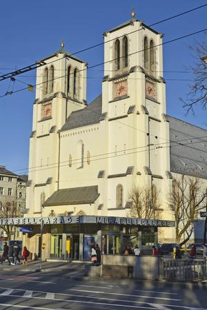 carpark: Salzburg, Austria - December 26th 2015: Unidentified people and Saint Andreas church with underground carpark below