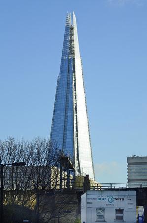sky scraper: London, Great Britain - January 15th 2016: Sky scraper - The Shard - aka Shard London Bridge Editorial