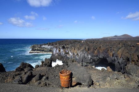 tourist attraction: Spain, Lanzarote, natural spectacle and tourist attraction Los Hervideros Stock Photo