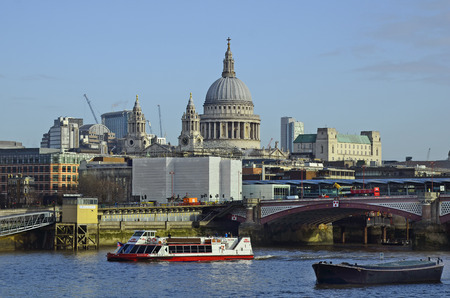 blackfriars bridge: London, Great Britain - January 16th 2016: Blackfriars bridge, excursion boat on river Thames and St. Pauls catherdal in background
