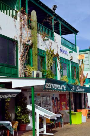 playa blanca: Playa Blanca, Canary Island, Spain- January 15th 2012: Restaurants with cactus on facade at beach promenade in Lanzarote