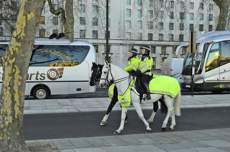 female police: London, Great Britain - January 15th 2016: Unidentified female police on horseback in the streets of London