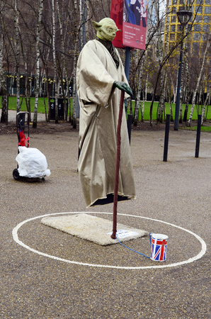 disguises: London, Great Britain - January 17th 2016: Unidentified street performer discuised with levitating overground