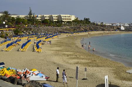 dorada: Playa Blanca, Canary Island, Spain - January 15th 2012: Unidentified tourists enjoy relaxing on beach of Playa Dorada in Lanzarote