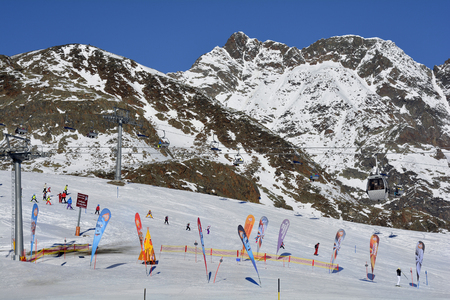 wintersport: Stubai, Austria - December 23rd 2015: Unidentified people and cable car in ski resort Stubaier glacier, preferred area for wintersport
