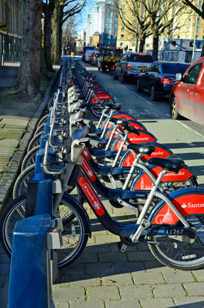 preferred: London, Great Britain - January 15th 2016: Station for rentable bicycles and bike path, a preferred mode of transport in the city