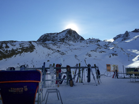 december sunrise: Stubai, Austria - December 20th 2015: Sunrise and unidentified people enjoy a sunny day with relaxing and sport on the glacier in Austrian alps Editorial