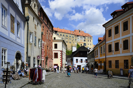 unesco in czech republic: Cesky Krumlov, Czech Republic - August 11th 2013: Street with unidentified tourists, restaurant, shops and part of the castle in the Unesco World Heritage site in Bohemia Editorial