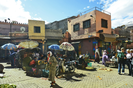 marrakesh: Marrakesh, Morocco - November 22nd 2014: Unidentified people on street market with different goods and food