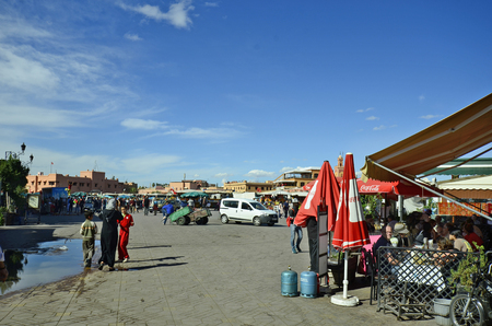 marrakesh: Marrakesh, Morocco - November 22nd 2014: Unidentified people, restaurants and shops on Djemaa Elfna square, a Unesco World Heritage site