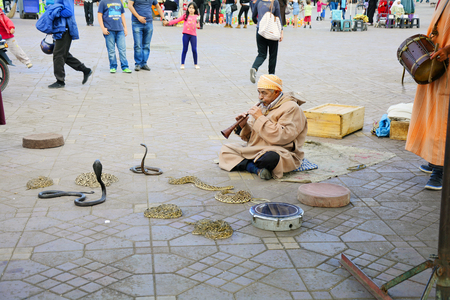 charmer: Marrakesh, Morocco - November 22th 2014: Unidentified snake charmer on Djemaa el-Fna square - a Unesco world heritage site Editorial