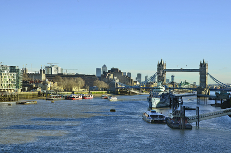 hms: London, United Kingdom - January 15th 2016: River thames with Tower, Tower bridge and warship HMS Belfast