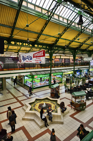 market hall: Sofia, Bulgaria - September 28th 2013: Unidentified people and different gallery shops in the Central Sofia Market Hall, a covered market in the centre of the capital