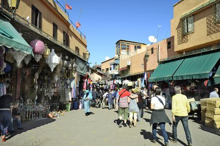 souk: Marrakesh, Morocco - November 22nd 2014: Unidentified people and different shops in the souk of the city at Djemaa el-Fna