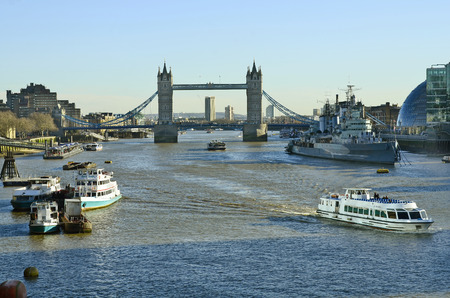 hms: London, United Kingdom - January 15th 2016: River thames with Tower bridge and warship HMS Belfast