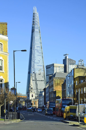 southwark: London, United Kingdom - January 15th 2016: Traffic around church St George the Martyr in Southwark and The Shard building in background