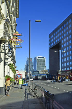 cheese grater: London, United Kingdom - January 15th 2016: Unidentified people and building with sky garden and Leadenhall building aka cheese grater