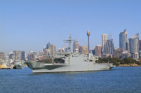 port jackson: Sydney, Australia - May 10th 2010: Worship of Australian navy in Port Jackson with skyline of the city