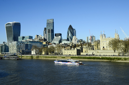 cruising: London, United Kingdom - January 15th 2016: Cruising ship on river Thames and Tower of London, sky garden building, leadenhall building aka cheese grater and The Gherkin aka 30 St.Mary street Editorial