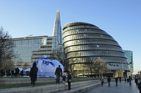 shard: London, United Kingdom - January 15th 2016: Unidentified people and new city hall with scyscraper the shard in background