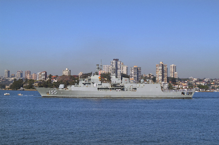 port jackson: Sydney, Australia - May 10th 2010: Worship of Australian navy in Port Jackson, buildings on darling point behind