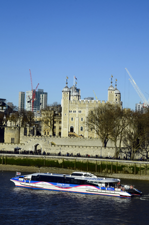 cruising: London, United Kingdom - January 15th 2016: Cruising ship on river Thames and tower of London