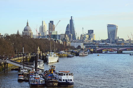 blackfriars bridge: London, United Kingdom - January 16th 2016: Blackfriars bridge over river Thames and different buildings, St. Pauls cathedral, Heron Tower, B42 tower aka Kirch Buys tower, The Gherkin, cheese grater aka Leadenhall building and Sky garden building aka Wal Editorial