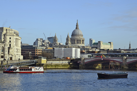 blackfriars bridge: London, United Kingdom - January 16th 2016: Blackfriars bridge over river Thames and different buildings, St. Pauls Cathedral