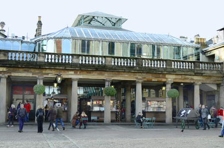 covent garden market: London, United Kingdom - January 16th 2016: Unidentified people on square in front of Covent Garden market hall
