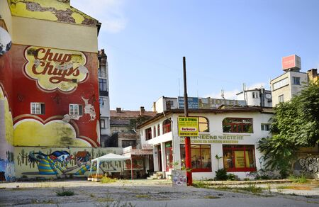 advertisements: Sofia, Bulgaria - September 28th 2013: Graffiti, advertisements and shabby hotel-restaurant in down town Sofia