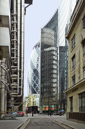 gherkin: London, United Kingdom - January 17th 2016: Norrow street, buildings and The Gherkin building on Tower Hill Editorial