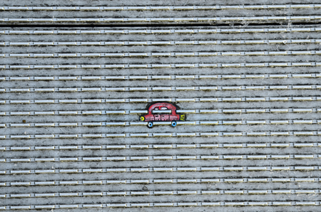 wilson: London, United Kingdom - January 17th 2016: Miniature paintings on bottom of Footh path of Millennium bridge made from chewing gum by artist Ben Wilson Editorial