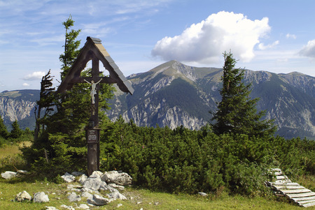 wayside: Austria, wayside cross on Rax mountain with Schneeberg mountain behind