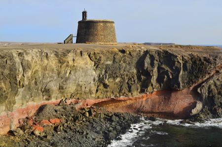 playa blanca: Torre del ?%u0192?guila with Castillo de Las Coloradas in Playa Blanca, Lanzarote