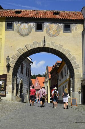 unesco in czech republic: Cesky Krumlov, Czechia, unidentified tourists and arch of castle Krumlov with sgraffito decorated facade in the Unesco World Heritage site in Bohemia
