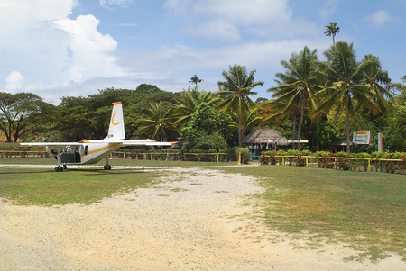 airstrip: Malolo Lailai Island, Fiji - March 19th 2005: Small aircraft on airstrip of of Plantation Island Resort on the tiny island in South Sea