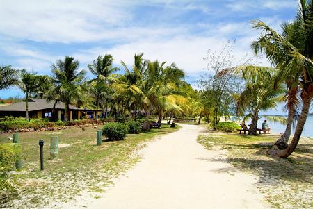 Fiji, bungalows and cocos palms on Malolo Lailai island