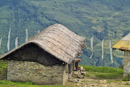 bhutan: Bhutan, homes with bamboo roofing in mountain village Wamrong Stock Photo