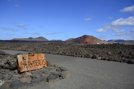 los hervideros: spain, sign to the natural spectacle and tourist attraction Los Hervideros on Lanzarote Stock Photo