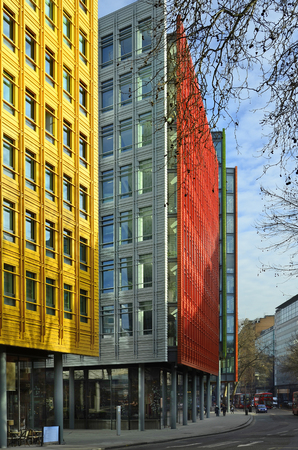 giles: London, United Kingdom - January 19th 2016: Colorful facade of Central Saint Giles - an office and residential buildings with different shops Editorial