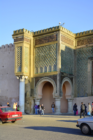 bab: Meknes, Morocco - November 19th 2014: Unidentified people in front of impressive Bab el-Monsour gate, a tourist attraction in the city Editorial