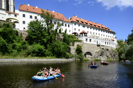 unesco in czech republic: Cesky Krumlov, Czech Republic - August 11th 2013: Unidentified people in rubber raft on Vltava river in the Unesco World Heritage site in Bohemia, rafting is a preferred sport on this part of river Vltava