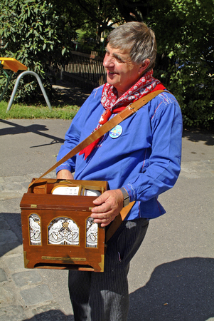 prater: Vienna, Austria - September 2nd 2005: Unidentified man playing small barrel organ in Bohemian Prater