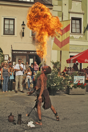 eater: Eggenburg, Austria - September 11th 2005: Unidentified fire eater and spectators by yearly medieval festival in the city in Lower Austria Editorial