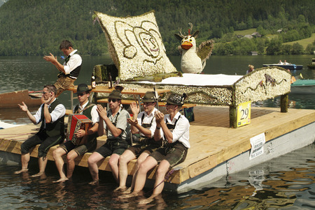 lederhose: Bad Aussee, Austria - May 30th 2005: Unidentified men in traditional outfit with harmonica by yearly festival of narcissus on Grundlsee lake Editorial