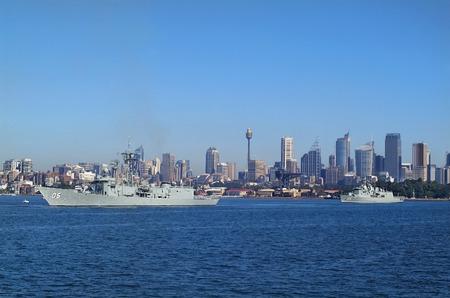 centrepoint tower: Sydney, Australia - May 10th 2010: Warships of Australian navy in Port Jackson, buildings and Centrepoint tower aka Sydney tower in background Editorial