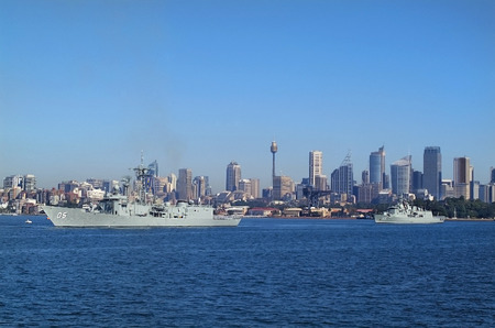 Sydney, Australia - May 10th 2010: Warships of Australian navy in Port Jackson, buildings and Centrepoint tower aka Sydney tower in background Editorial