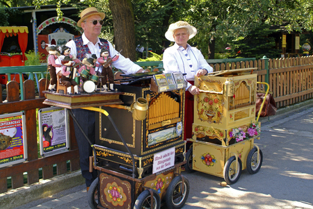 prater: Vienna, Austria - September 2nd 2006: Unidentified musician with barrel organ by meeting in Bohemian Prater in Vienna