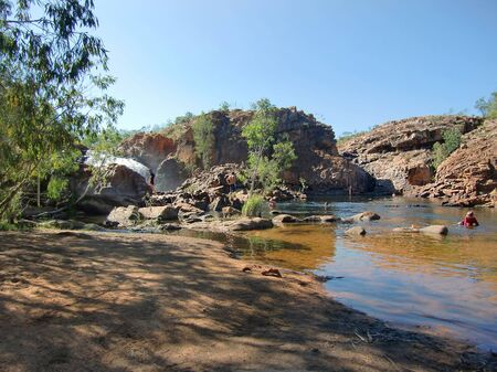 edith: Australia, people enjoy the natural pools of Edith Falls in Nitmiluk nationalpark Editorial
