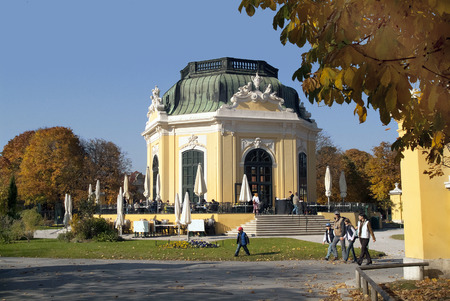 schoenbrunn: Vienna, Austria - October 30th 2005: Unidentified people enjoy a sunny autumn day in the park of Schoenbrunn with Kaiserpavillion - cafe Editorial
